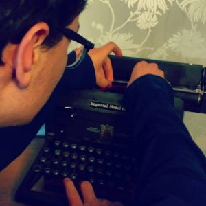 Marcel fixing a typewriter at the local cinema